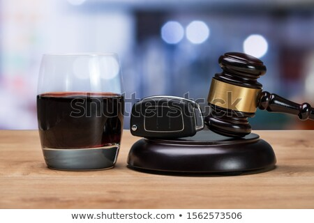 Car Key And Mallet On The Striking Block Over Table Stock photo © AndreyPopov