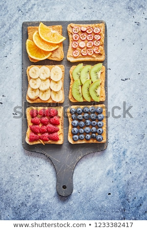 Wholegrain bread slices with peanut butter and various fruits Stock photo © dash