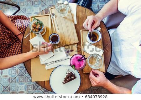 Mains amis table en bois café cappuccino temps Photo stock © pressmaster