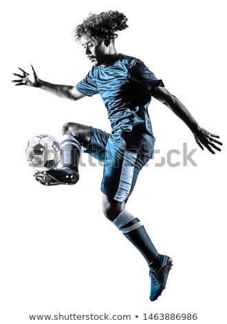 soccer player play in back lit Stock photo © Lopolo