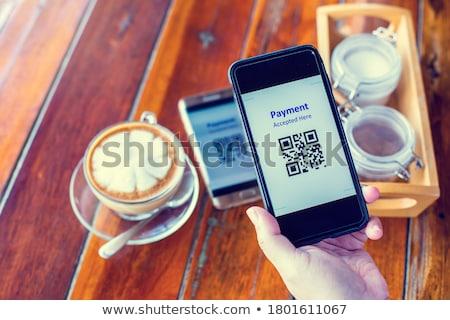 Teléfono móvil escanear pago código tienda mano Foto stock © AndreyPopov