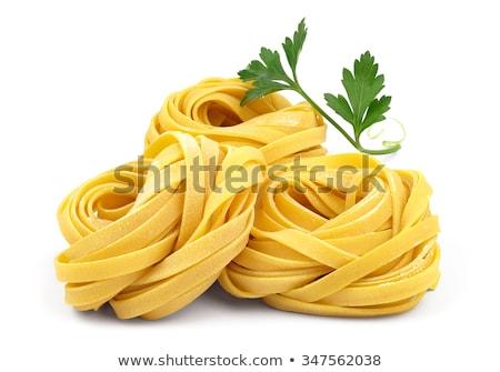 Nyers tészta fehér közelkép spagetti fókusz Stock fotó © elly_l