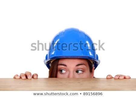 Tradeswoman peeping out from beneath a table Stock photo © photography33