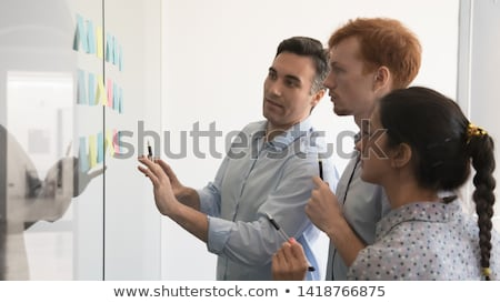 Stock photo: Yellow team with focus on the leader blue