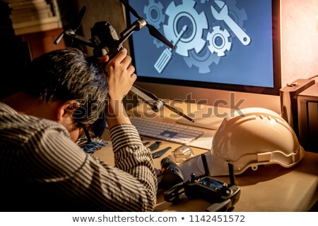 Frustrated engineer at a desk Stock photo © photography33