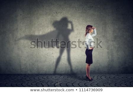 Schaduw vrouw sexy benen geïsoleerd beton Stockfoto © roboriginal