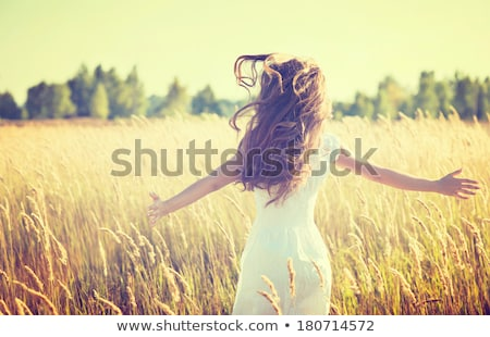 Girl dreaming in a white dress stock photo © michey