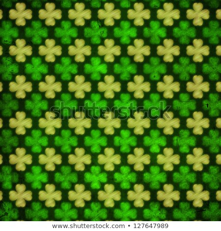 striped shamrocks in green old paper background out of focus Stock photo © marinini