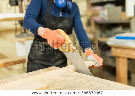 carpenter using hand saw stock photo © photography33