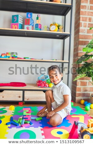 Smart boy playing with blocks stock photo © get4net