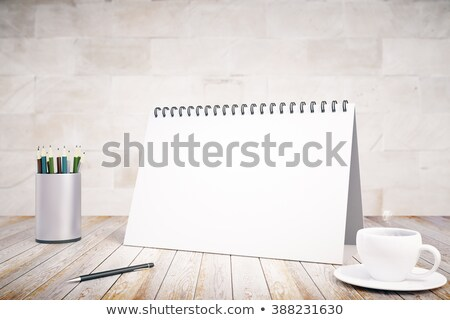 Stock photo: Notepad on stand with pencil