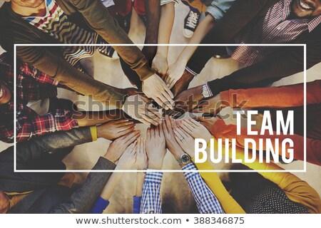 Human hands building the word 'team' Stock photo © Smileus