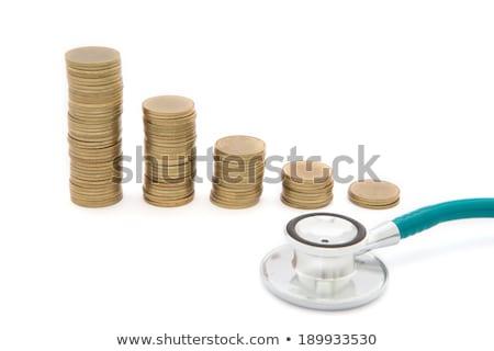 Estetoscopio monedas ahorro mal economía fondo Foto stock © rufous