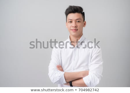 portrait of a smiling asian man over white background stock photo © deandrobot