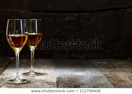 Two glasses of wine on the wooden background  Stock photo © CaptureLight