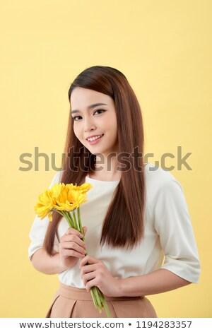 Smiling Vietnamese Woman Holding Fresh Flowers Stock photo © smithore
