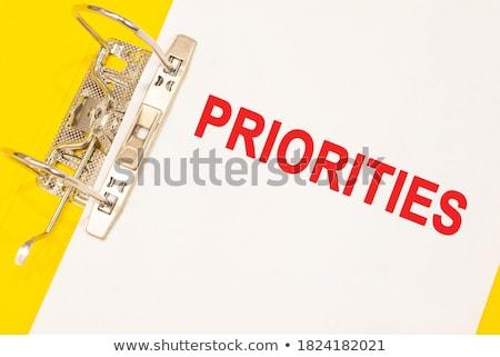 Priorities Concept with Word on Folder. Stock photo © tashatuvango
