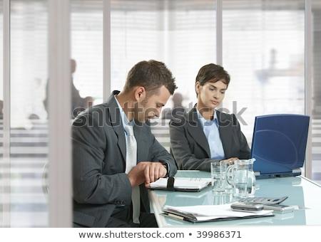 empresário · tempo · em · pé · escritório · entrada · olhando - foto stock © feedough