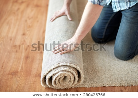 workers hands rolling carpet stock photo © andreypopov