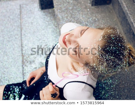 Stock photo: young pretty party girl smiling covered with glitter tinsel, fashion dress, stylish make up, lifesty