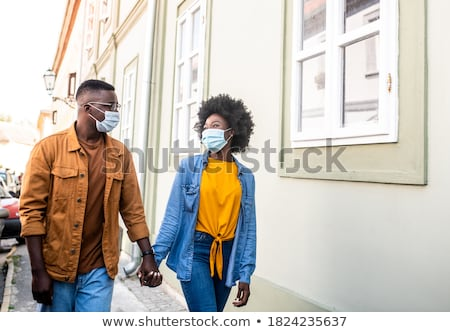 couple walking down street stock photo © is2