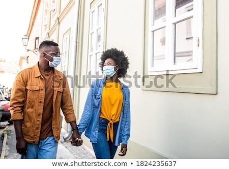 пару ходьбе вниз улице женщину человека Сток-фото © IS2