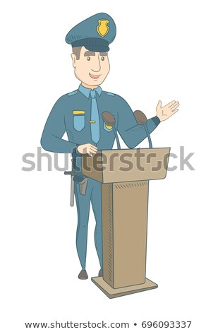Young policeman giving a speech from the tribune. Stock photo © RAStudio