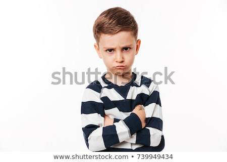 angry little boy child with arms crossed stock photo © deandrobot