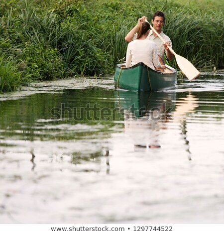 Couple in paddle boat on lake Stock photo © IS2