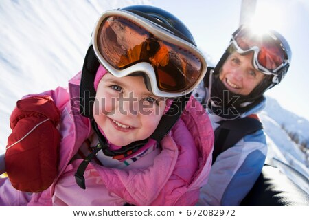young girl and grandmother on chair lift stock photo © is2