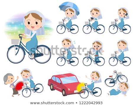 Nun women_city cycle Stock photo © toyotoyo