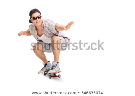 Hipster man riding skateboard Stock photo © jossdiim