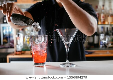 man pouring cocktail into the glass stock photo © kzenon