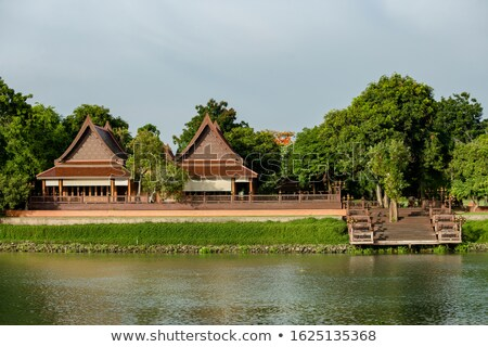 Thai style house in the water Stock photo © colematt