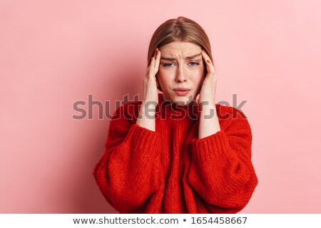 Displeased young woman posing isolated over pink background wall. Stock photo © deandrobot