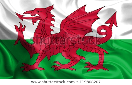 Two waving flags of UK and wales Stock photo © MikhailMishchenko