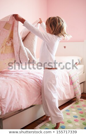 Girls in Pajamas Making Bed Stock photo © colematt
