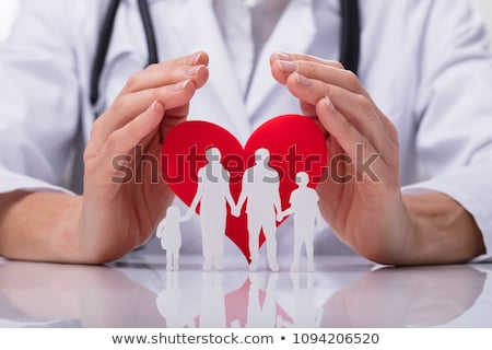Stock photo: Doctor Protecting Family Cut Out And Heart Shape