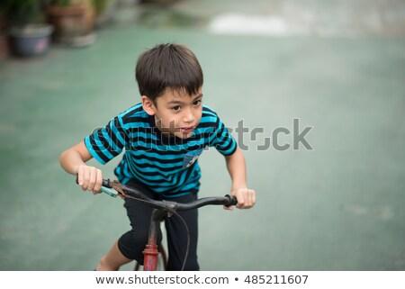 Arab boy_city cycle Stock photo © toyotoyo