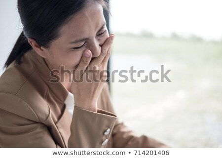 Asian business woman crying, Businesswoman was tired out from th Stock photo © Freedomz