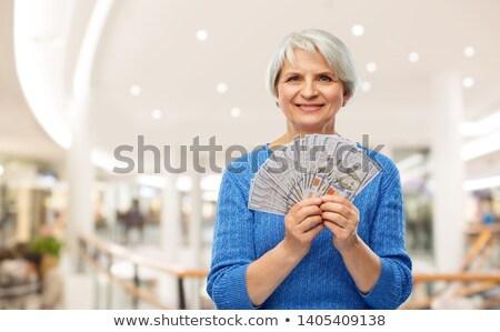 Senior Frau Dollar Geld Einkaufszentrum Einsparungen Stock foto © dolgachov