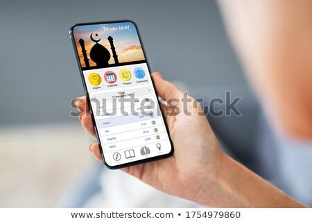 Nő muszlim ima app mobiltelefon kéz Stock fotó © AndreyPopov