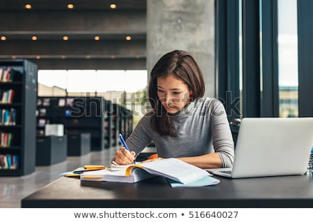 Young female student preparing for exams at library  Stock photo © Elnur