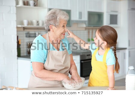 Granddaughter cooking for her grandmother Stock photo © photography33