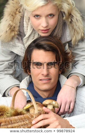 a couple wearing warm clothes after mushroom picking stock photo © photography33