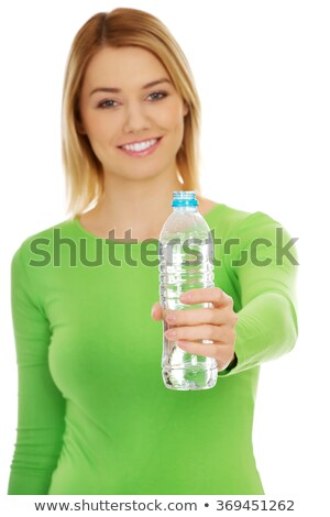 A smiling sportswoman holding a bottle. Stock photo © photography33