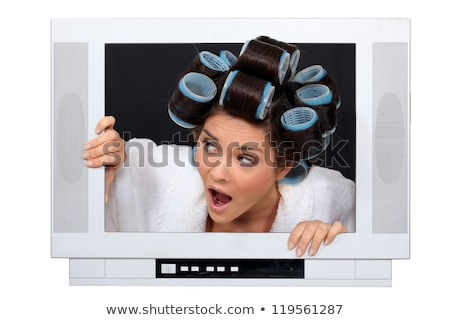 Woman escaping from inside television Stock photo © photography33
