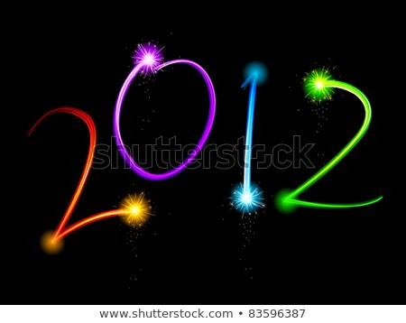 new 2012 year with fireworks stock photo © shutswis