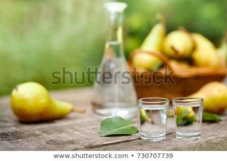 Twee flessen vruchten geïsoleerd witte Stockfoto © Gbuglok