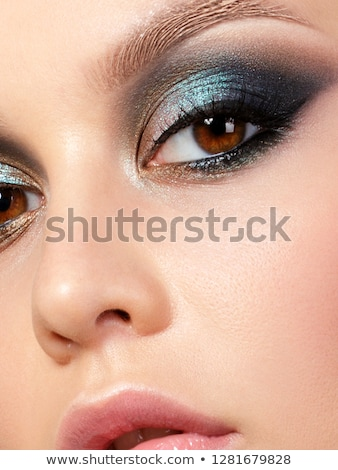 beautiful woman with extreme colorfull make up in turquoise Stock photo © juniart